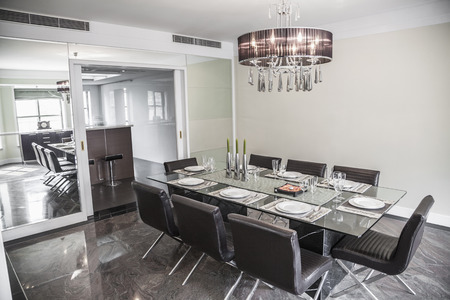dining room: Dining room with modern furniture and chandelier.