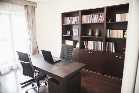 Modern home office with bookshelves. Stock Photo