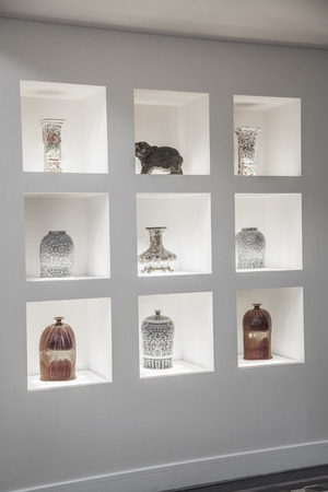 Built in shelves with an assortment of vases.  Stock Photo