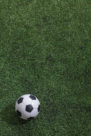 soccer ball on grass: Soccer field with soccer ball  Stock Photo