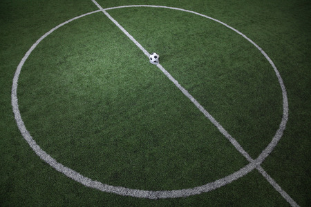 Soccer field with soccer ball on the line, high angle view Stock Photo