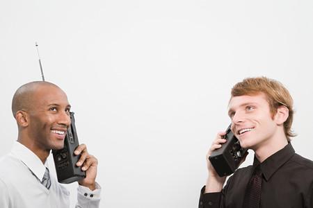 afro caribbeans: Two men using walkie talkies