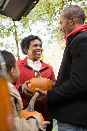 afro caribbean ethnicity: Family with pumpkins