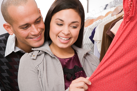 coathangers: Couple shopping Stock Photo