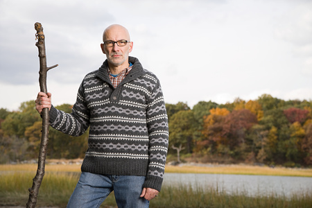 1 adult only: Mature man holding a stick
