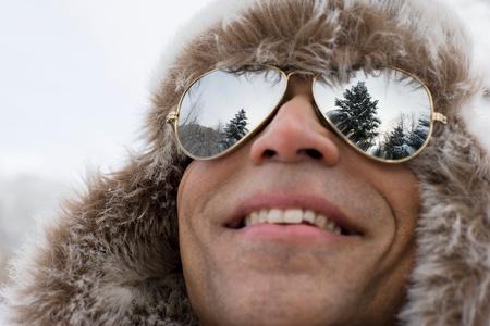 bi racial: A man wearing a deerstalker hat and sunglasses
