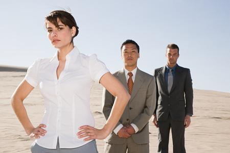 Businesspeople in desert