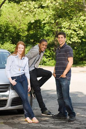 afro caribbean ethnicity: Three young friends with a car