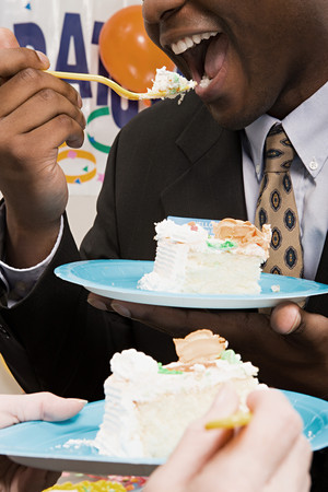 Office workers eating party cake