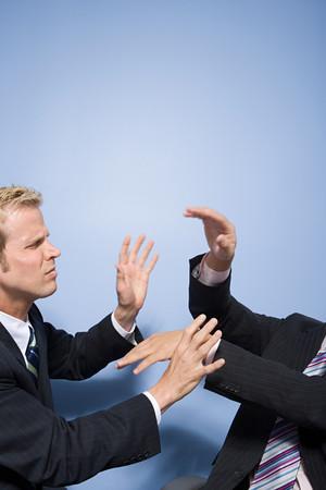 fuming: Businessmen fighting