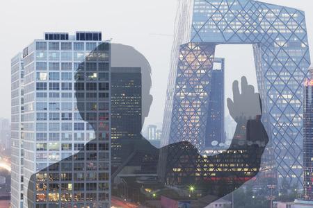 bigger picture: Businessman looking at CCTV building in Beijing, Double exposure Stock Photo