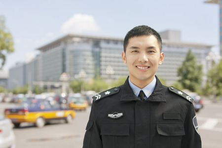 Police Officer Smiling, Portrait, China Stock Photo