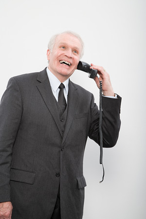 silliness: A businessman using a broken phone Stock Photo