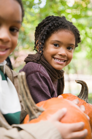differential focus: Kids with pumpkins Stock Photo