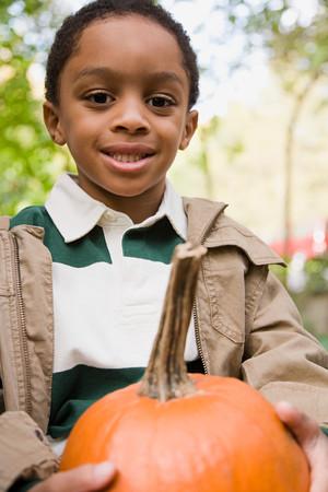 afro caribbeans: Boy holding a pumpkin