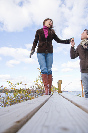 chuckling: A couple holding hands Stock Photo