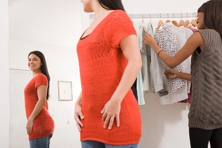 afro caribbeans: Women in clothes shop Stock Photo