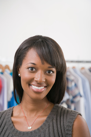 afro caribbean ethnicity: Young woman in a shop