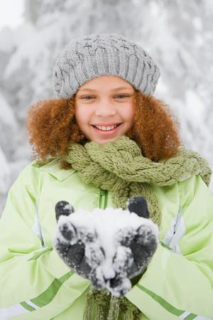 bi racial: Girl with snow Stock Photo