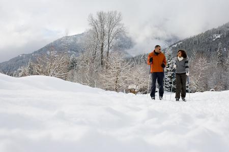 A mature couple skiing photo