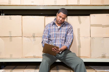 afro caribbean ethnicity: Man in warehouse Stock Photo