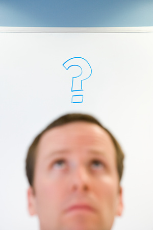 30 to 40 year olds: Man with question mark above his head Stock Photo