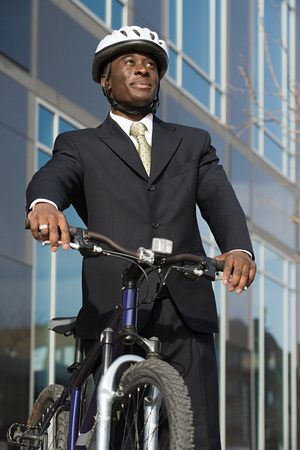afro caribbeans: Businessman with bicycle