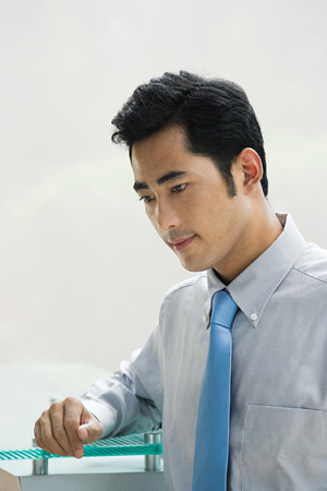 18 25 year old: Thoughtful looking businessman Stock Photo
