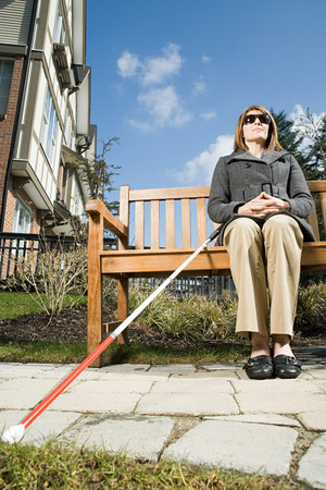 matures: Blind woman sitting on a bench