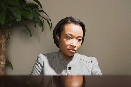 afro caribbean ethnicity: Business woman looking worried