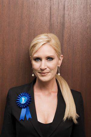 winning mood: Businesswoman wearing rosette