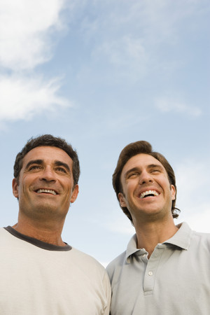 chuckling: Two men smiling