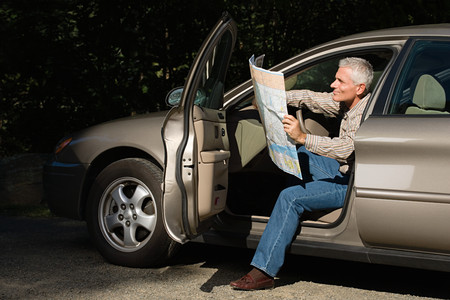 1 adult only: Man looking at map Stock Photo