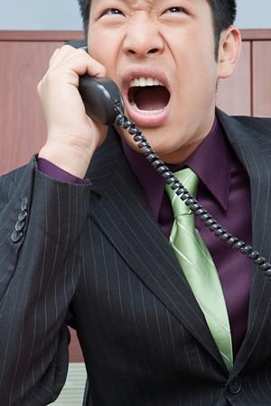 fuming: Stressed businessman