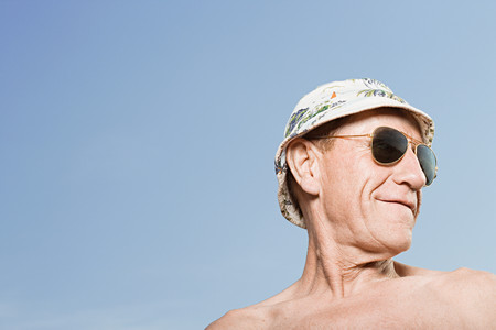 partially nude: Man wearing sunhat and sunglasses Stock Photo
