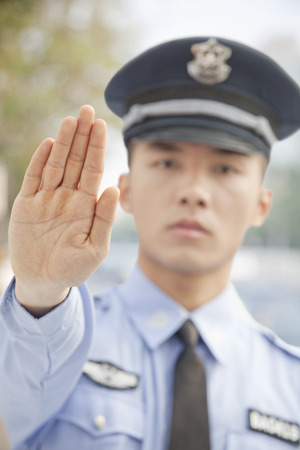 safety officer: Police Officer Motioning to Stop