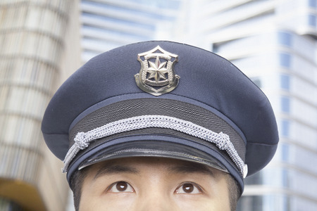 police body: Police Officer, Half Face, Looking Up Stock Photo