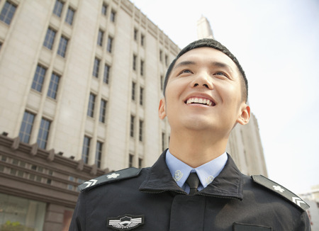a police officer: Police Officer Smiling, low angle view