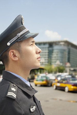 police officer: Police Officer looking up, profile Stock Photo
