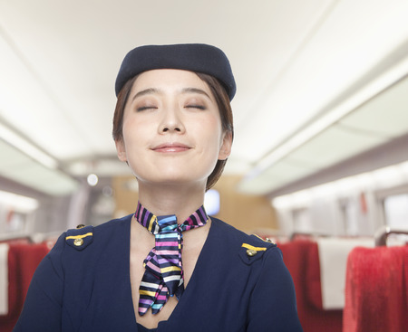 stewardess: Portrait of Air Stewardess, Eyes Closed Stock Photo