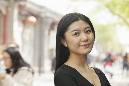 incidental people: Young Woman smiling looking at camera