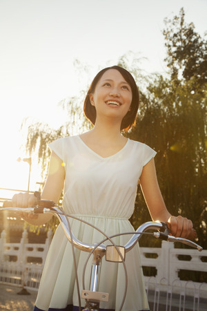 Young Woman on Bicycle photo