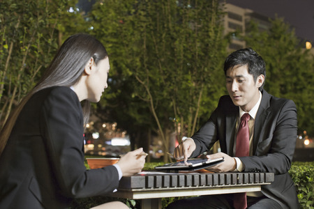 Business People Working While Having Dinner