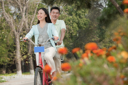 tandem bicycle: Couple riding tandem bicycle in Beijing Stock Photo
