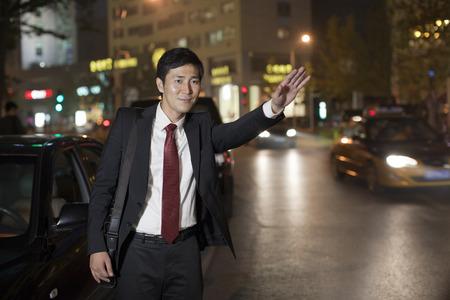 hailing: Businessman Hailing Taxi Cab