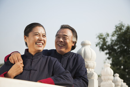 Senior couple dressed in traditional Chinese clothing, portrait