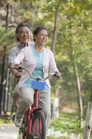 tandem bicycle: Older couple riding tandem bicycle, Beijing