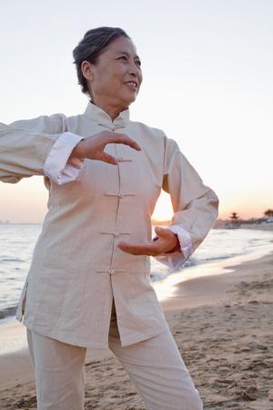 mature women: Mature women practicing Taijiquan, China Stock Photo
