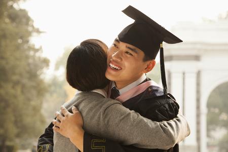 graduate: Mother and Graduate Hug Stock Photo