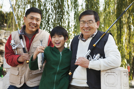 generation gap: Multi-generational men fishing portrait